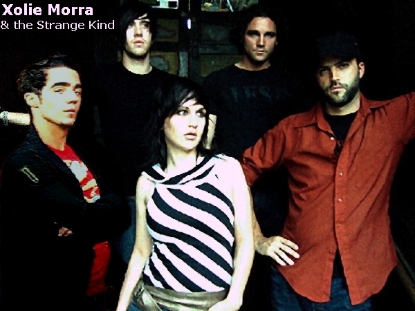 http://indiemusicpeople.com/uploads2/Xolie_Morra_and_The_Strange_Kind_-_full_band_words.jpg
